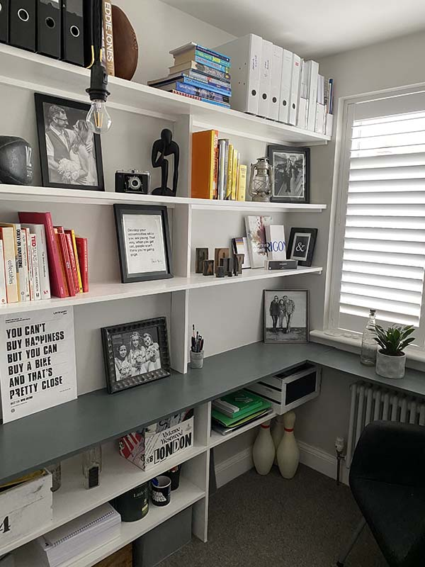 Shelving and desk for small study area.